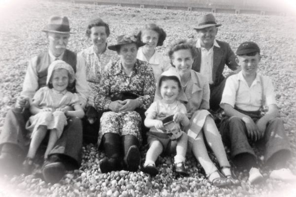 A day at the beach: Mum (far left, in hat) with grandparents, parents, aunt, siblings and cousin!) c1950